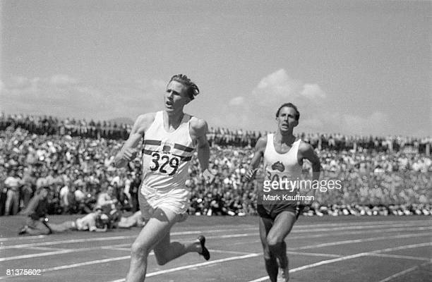Track Field British Empire and Commonwealth Games GBR Roger Bannister in action vs AUS John Landy during mile race Vancouver CAN 8/2/1954
