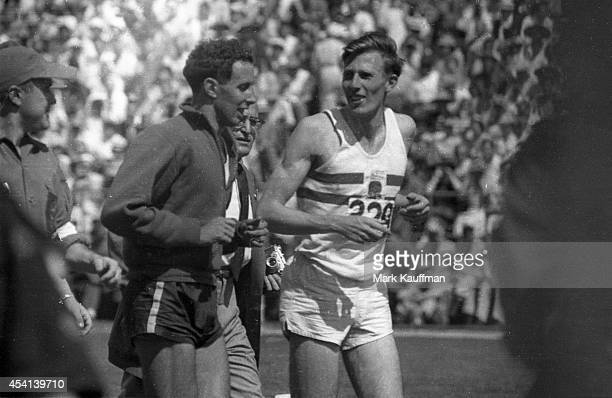 British Empire and Commonwealth Games Great Britain Roger Bannister victorious talking to Australia John Landy after winning mile race at Empire...
