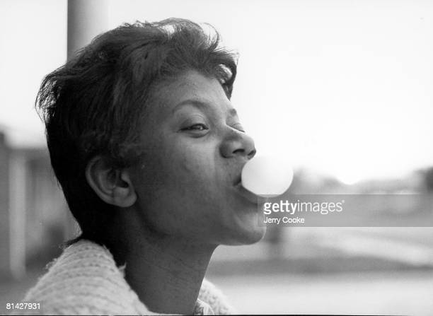 Track Field Closeup portrait of Wilma Rudolph with bubble gum at home TN 6/17/1964