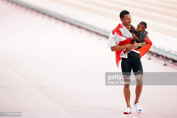 World Athletics Championships: Canada Andre De Grasse victorious wearing Canadian flag and carrying his daughter Yuri after Men's 100M Final at...