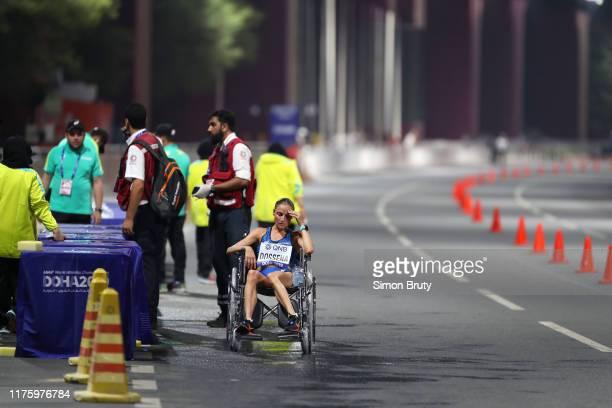 World Athletics Championships: Italy Sara Dossena sitting in wheelchair after Women's Marathon Final at Khalifa International Stadium. Doha, Qatar...