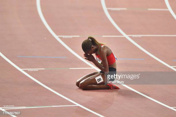World Athletics Championships: Kenya Beatrice Chepkoech victorious on her knees on track after winning Women's 3000M Steeplechase Final at Khalifa...