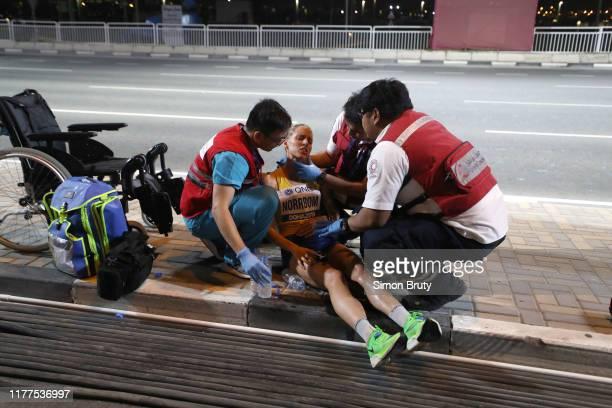 World Athletics Championships: Sweden Cecilia Norrbom down with injury during Women's Marathon Final at Khalifa International Stadium. Doha, Qatar...