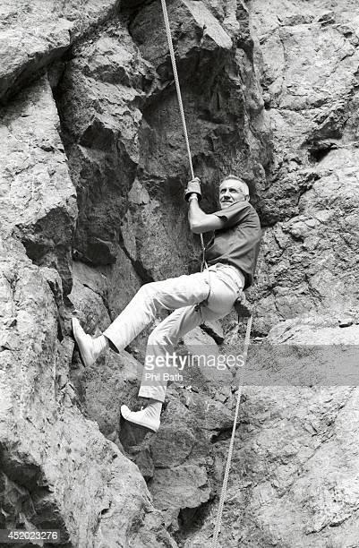Portrait of former Olympian Louis Zamperini rappelling on Mammoth Mountain Zamperini a prisoner of war survivor from World War II takes deliquent...