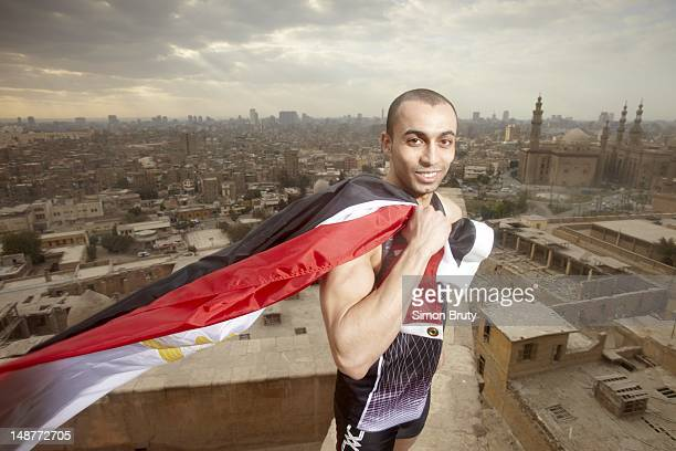 Summer Games Preview Closeup portrait of 200M runner Amr Seoud of Egypt during photo shoot on the Cairo Citadel View of Al Rifa'i Mosque and...