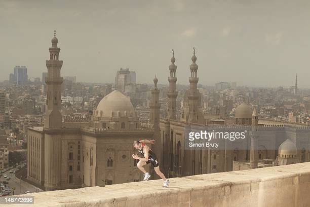 Summer Games Preview Portrait of 200M runner Amr Seoud of Egypt during photo shoot on the Cairo Citadel View of Al Rifa'i Mosque and MosqueMadrassa...