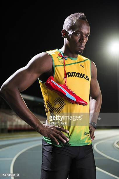 Summer Games Preview Portrait of Jamaica Usain Bolt posing during photo shoot on track at Truman Bodden Sports Complex George Town Cayman Islands...