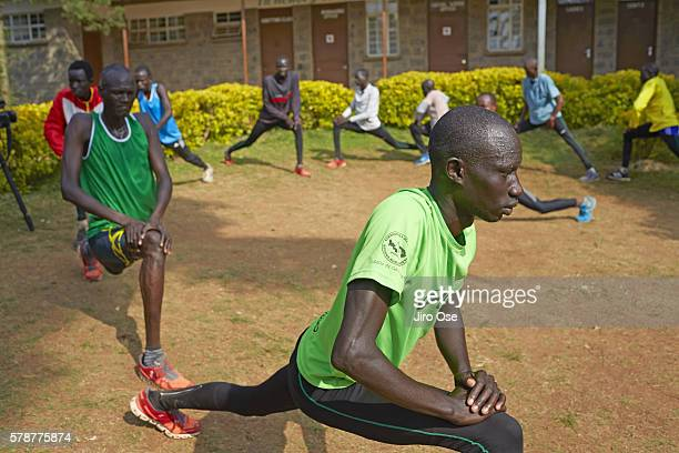 Summer Games Preview: View of Refugee Olympic Team James Nyang Chiengjiek in action, stretching at the Tagla Lorupe Training Center. The IOC created...