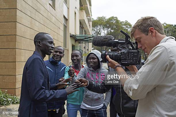 Summer Games Preview: View of Refugee Olympic Team James Nyang Chiengjiek answering question in a mock interview during a media training at the Tagla...