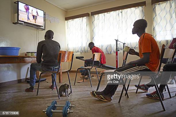 Summer Games Preview: View of Refugee Olympic Team Yiech Pur Biel and his team mates watching television at the Tegla Lorupe Training Center. The IOC...