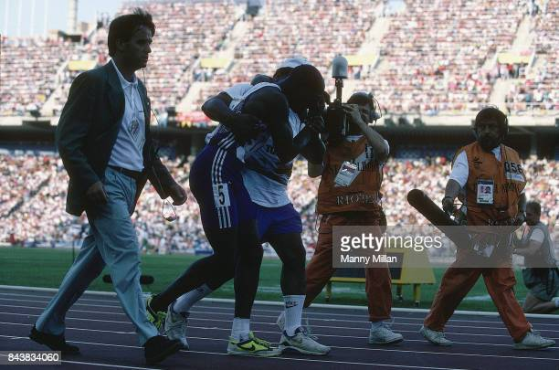 Summer Olympics Great Britain Derek Redmond being helped by father on track after suffering injury during Men's 400M semifinal race at Estadi Olímpic...