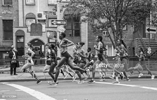 TCS New York City Marathon View of runners in action in Williamsburg neighborhood during race Brooklyn NY CREDIT Erick W Rasco