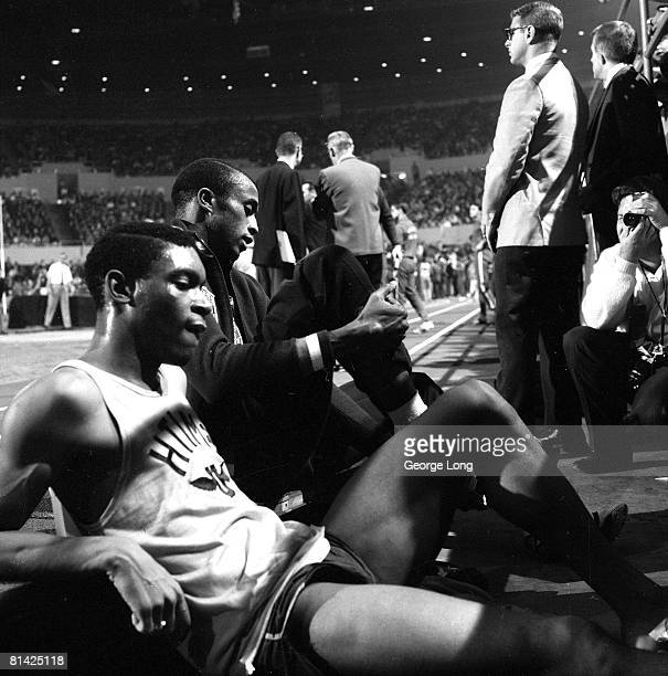 Track & Field: LA Times Indoor Games, AAU Tommie Smith before race at The Forum, Inglewood, CA 1/19/1968