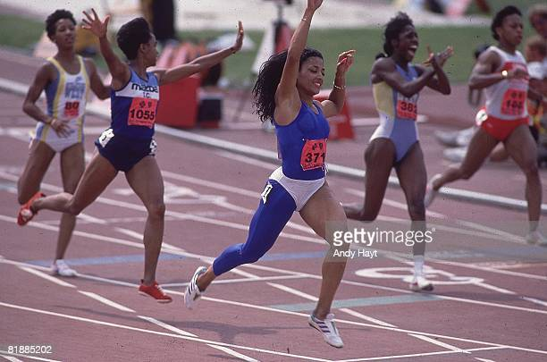 Track Field US Olympic Trials Florence GriffithJoyner victorious after winning 100M Finals and breaking world record with 1049 at IUPUI Carroll...