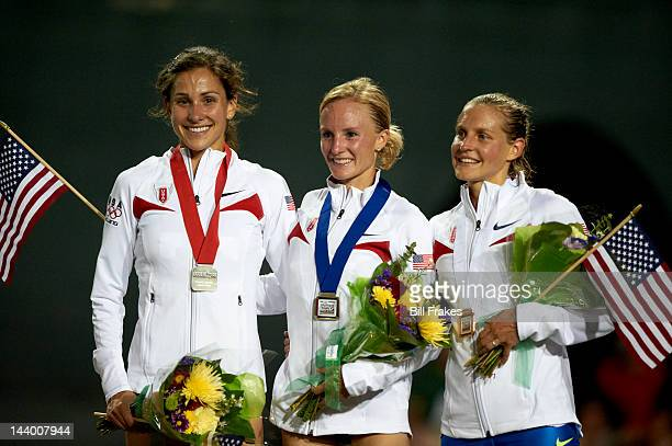 US Olympic Trials Kara Goucher Shalane Flanagan and Amy Begley victorious with medals and flags after winning Women's 10000M Final at Hayward Field...