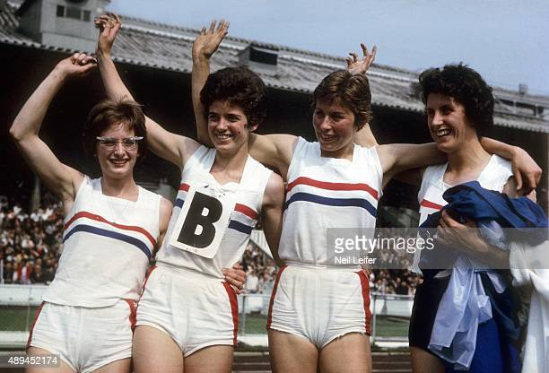 USGreat Britain Track Meet Great Britain Madeleine Cobb Daphne Arden Mary Rand and Dorothy Hyman victorious after winning Women's 440 Yard Relay race...