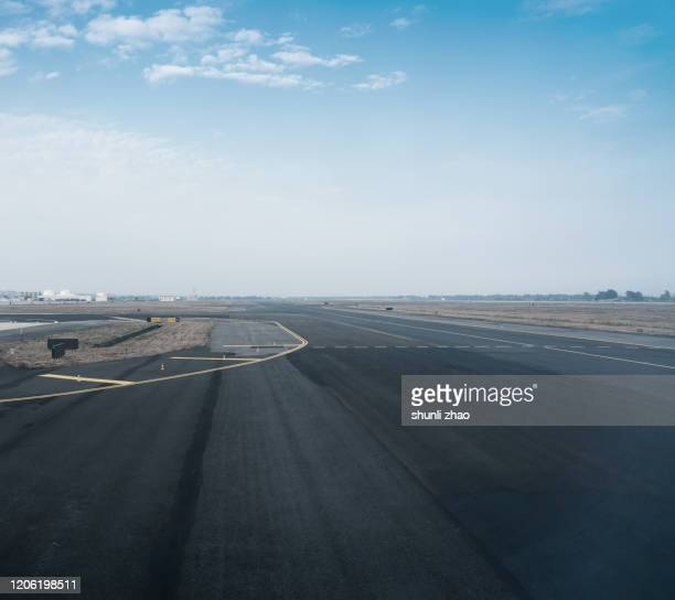 a track full of tire marks - airfield stock pictures, royalty-free photos & images