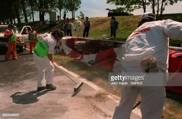 Track marshalls clear up after Olivier Panis accident