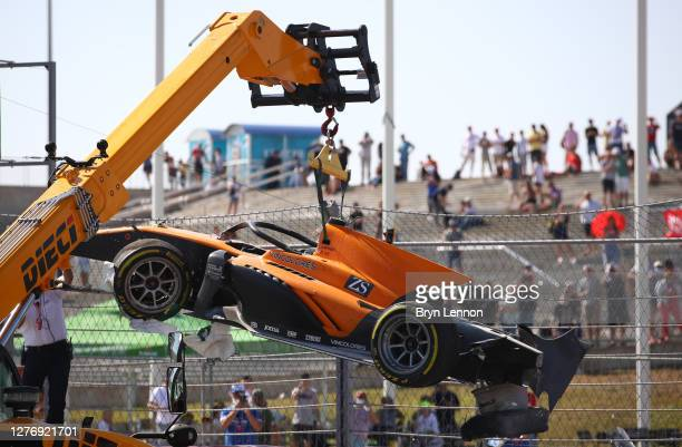 Track marshals clear the debris after a crash between Jack Aitken of Great Britain and Campos Racing and Luca Ghiotto of Italy and Hitech Grand Prix...