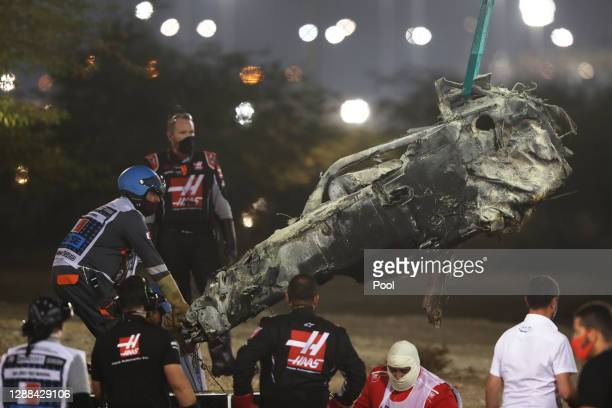 Track marshals clear the debris following the crash of Romain Grosjean of France and Haas F1 during the F1 Grand Prix of Bahrain at Bahrain...