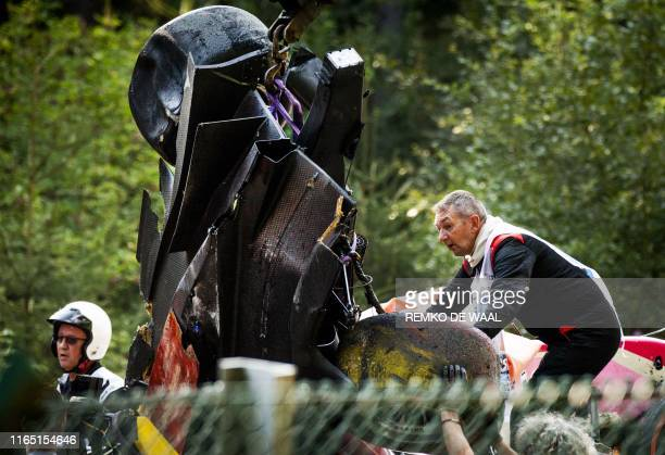 Track marshals lift the damaged car of BWT Arden's French driver Anthoine Hubert onto a truck following a serious accident involving several drivers...