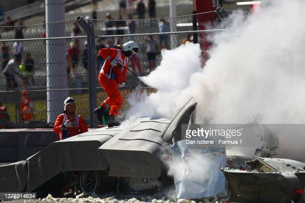 Track marshals put out a fire after a crash between Jack Aitken of Great Britain and Campos Racing and Luca Ghiotto of Italy and Hitech Grand Prix...