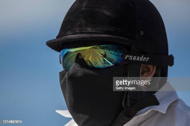 Track officer observes the court before the race during competition day as Uruguay slowly returns to normal due to coronavirus outbreak at Maroñas...