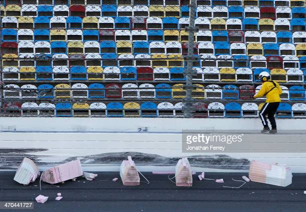 A track official works on damage to the SAFER barrier following an incident during practice for the NASCAR Sprint Cup Series Daytona 500 at Daytona...
