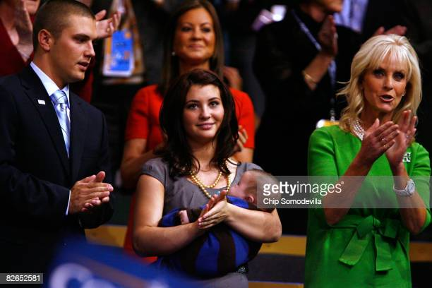 Track Palin Willow Palin holding Trig Palin and Cindy McCain wife of presumptive Republican US presidential nominee US Sen John McCain applaud on day...