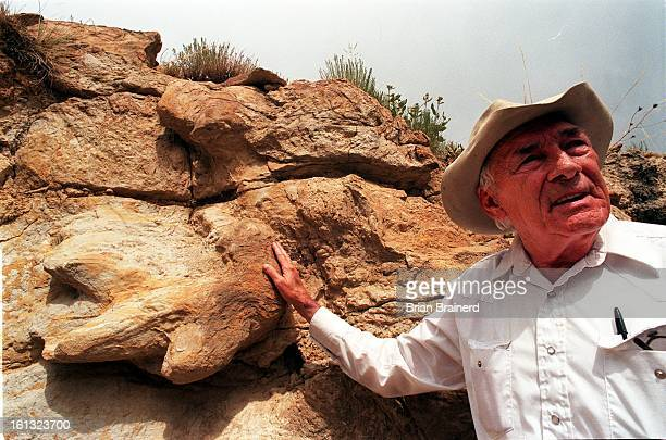 Track preservationist T Caneer former director of Dinosaur Ridge with a track probably left by a Triceratops at the site of Golden's new golf course