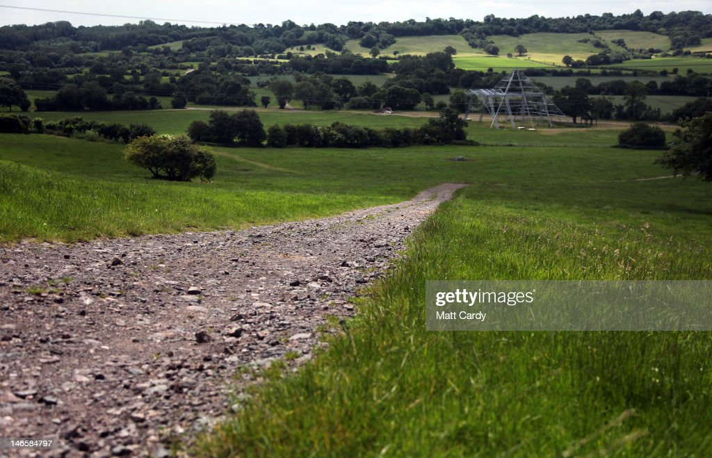 A track road leads down to the front of the skeleton of the main Pyramid Stage at the Glastonbury Festival site at Worthy Farm, Pilton on June 20, 2012 near Glastonbury, England. Today would have been the day that the gates would have opened for what has become Europe's biggest music festival, but because of the London 2012 Olympics it was decided by the organisers to take this year off. However, this week it was announced that the festival - which started in 1970 when several hundred festival-goers paid 1 GBP to watch Marc Bolan and has now attracts more than 175,000 people over five days - will feature in a mosh-pit style tribute in the opening ceremony of the London 2012 Olympic Games. The Festival will return in June 2013.