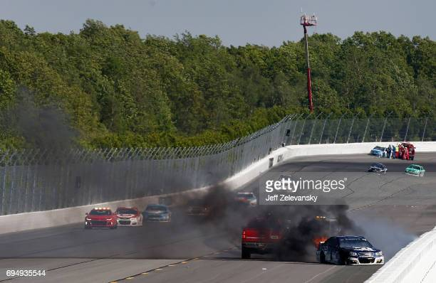 Track service vehicles respond to an ontrack incident involving Jamie McMurray driver of the Cessna Chevrolet during the Monster Energy NASCAR Cup...