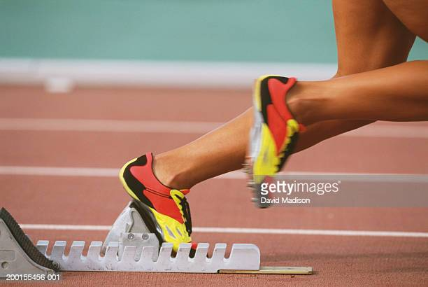 track sprinter taking off from starting block, low section - sprint stock pictures, royalty-free photos & images