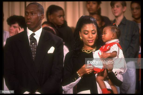 Track star couple Al Joyner Flo Jo Griffith Joyner w baby Mary in her arms paying call at Alice Deal Jr HS