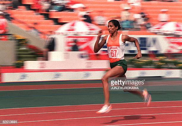 Track star PT Usha of India shown in photo dated 29 September 1986 streaking her way to pass in the women's 200meter heats with a new Asian games...
