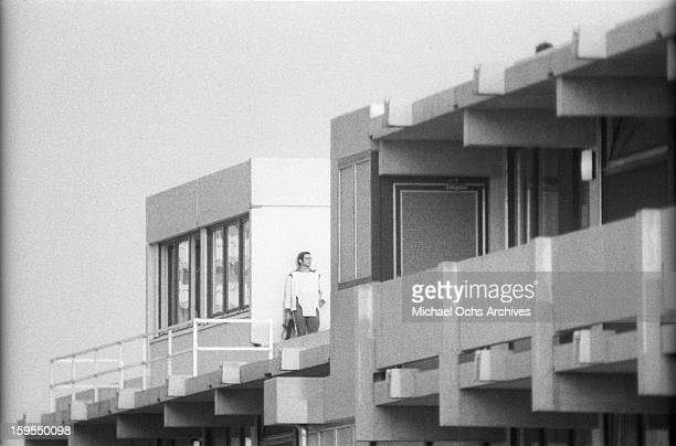 A track suited West German security official keeps and eye on the quarters of the Israili Olympic team where members of the Black September...