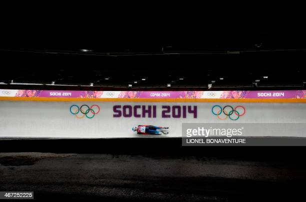 Track tester check the track during the women's Luge training session at the Sanki Sliding Centre in Rosa Khutor on February 6, 2014. AFP...