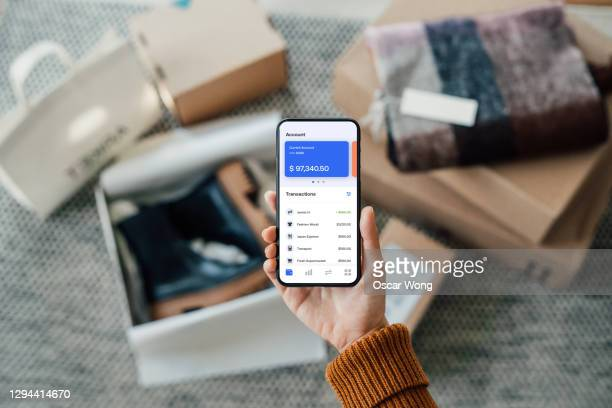 tracking bank account transactions with mobile banking - bank stock pictures, royalty-free photos & images