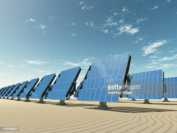 tracking solar panels in the desert - solar panels stock photos and pictures