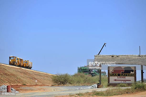Tracklaying machinery passes along a section of newly laid rail track at the Tsavo superbridge construction site which will form part of the new...