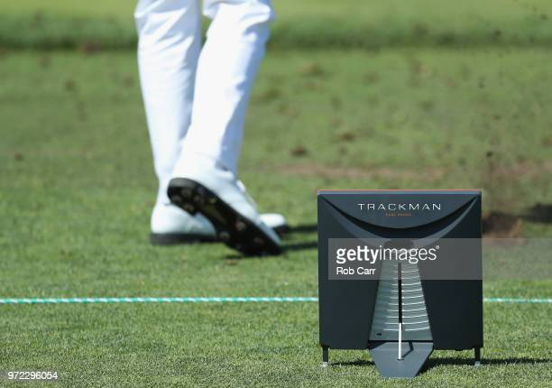 A trackman is seen as Justin Thomas of the United States plays a shot on the range during a practice round prior to the 2018 US Open at Shinnecock...