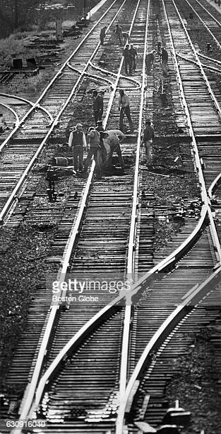 Trackmen lay down new ties for track two eastbound into Boston near Roxbury on Nov 12 1976