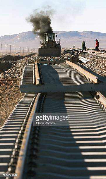 Tracks are laid at a construction site of the QinghaiTibet Railway on February 24 2006 in Anduo County of Tibet Autonomous Region China Global...