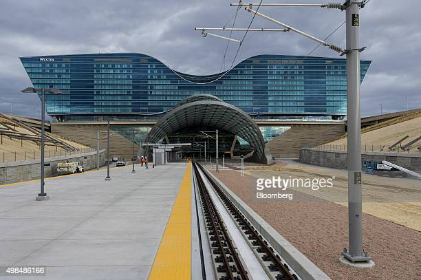 Tracks lead to the Denver International Airport station of the Regional Transportation District A Line commuter train line in Denver Colorado US on...