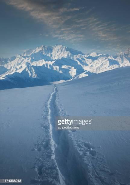 tracks through snow by monte rosa in piedmont, italy - monte rosa foto e immagini stock