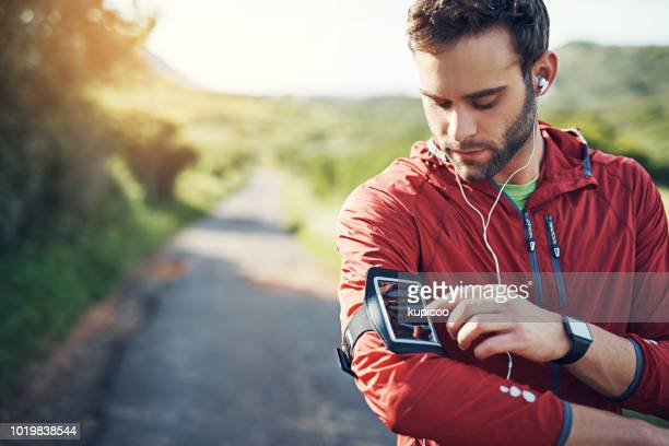 tracks to get him ready for the track - fitness tracker stock pictures, royalty-free photos & images