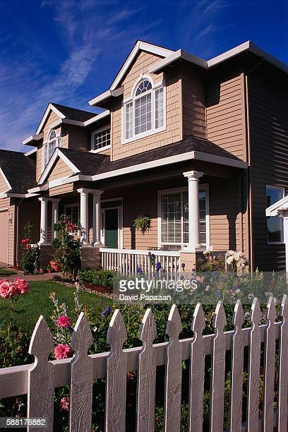 Tract House Behind Picket Fence