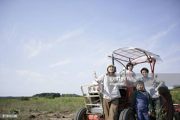 A tractor and a family