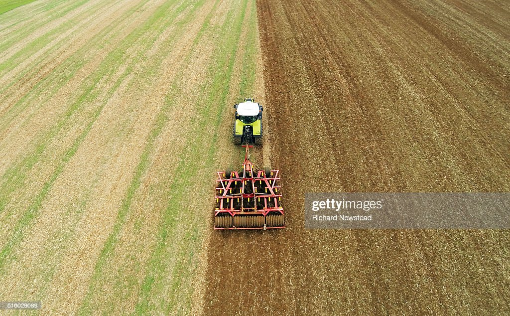 Tractor and Cultivator : Stock Photo