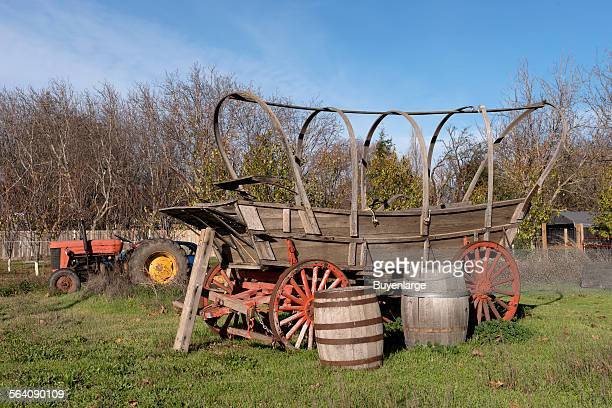 A tractor and framework of what appears to be an early pioneer wagon observed in a yard in Los Molinos a small town in Tehama County California